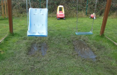 Muddy puddle under disabled swing
