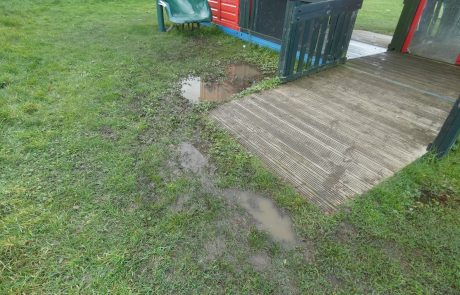 Muddy Puddle next to playground equipment