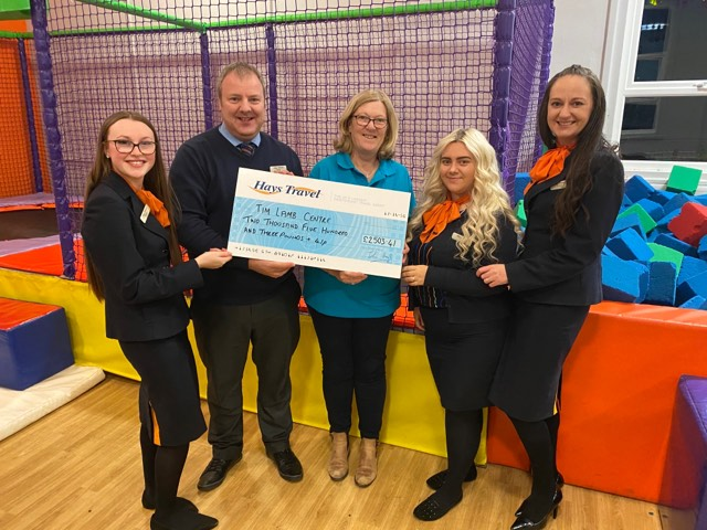 Hays Travel Whitley Bay presenting cheque