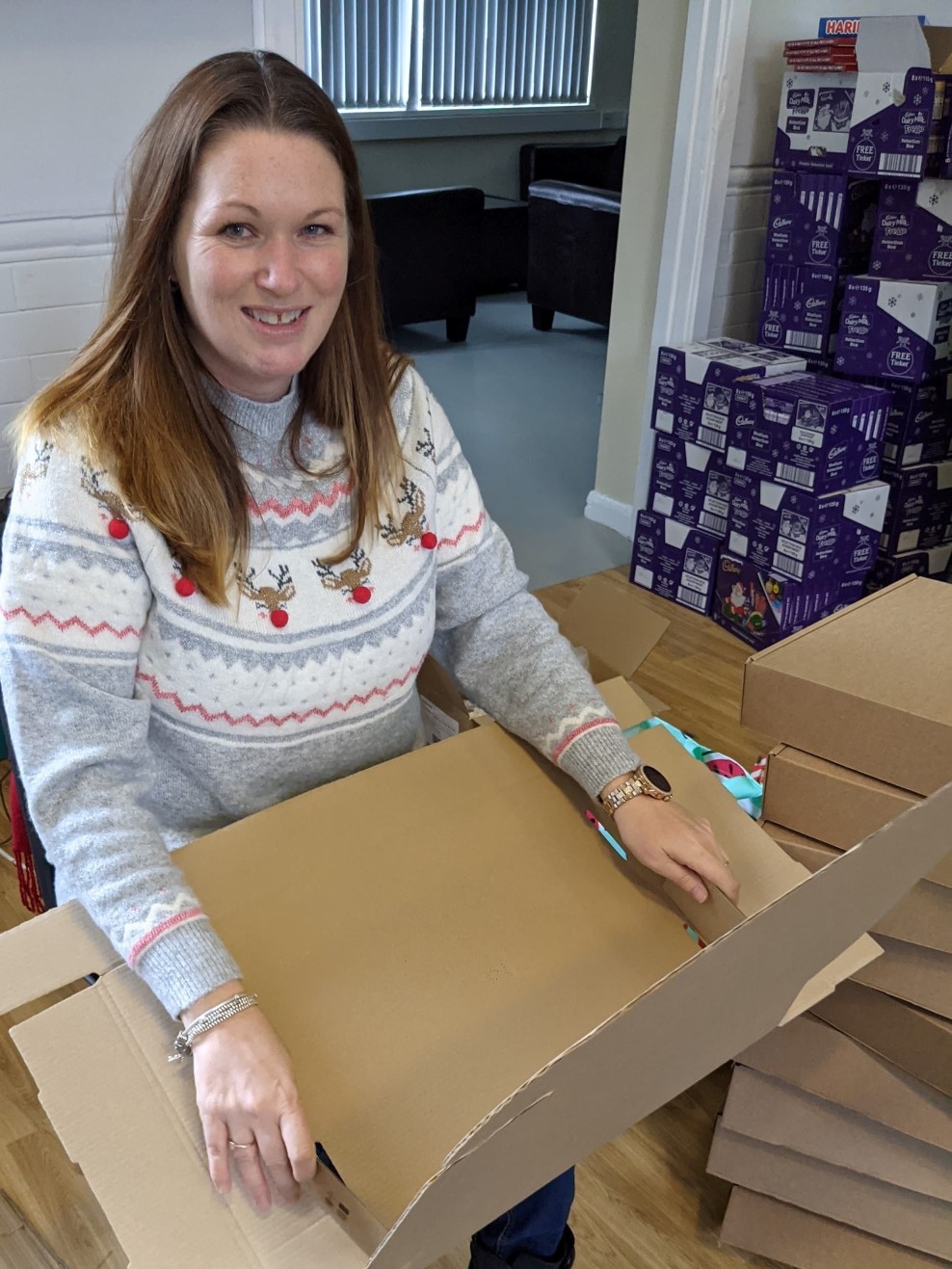 Volunteer making up boxes